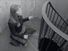 Janneke van der Putten, singing upstairs in the tower, holding the wire that communicates with the listener, Christian Galarreta, standing downstairs